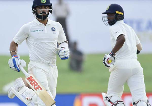 Kohli and Mukund lead India's charge